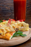 Spicy pizza on a wooden background Stock Image