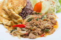 Spicy pork with basil and omelet Stock Image