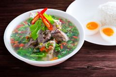 Spicy Pork with Pork bone Soup with Rice and Egg. Stock Photography