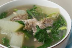 Spicy pork bone soup sprinkle with pepper. Thai food with rice Royalty Free Stock Images