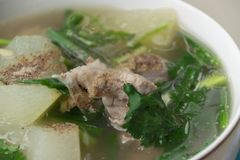 Spicy pork bone soup sprinkle with pepper. Thai food with rice Stock Images