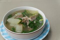 Spicy pork bone soup sprinkle with pepper. Thai food with rice stock photo