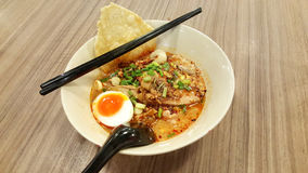 Spicy pork noodle tom yum soup with Half-boiled egg Royalty Free Stock Photography