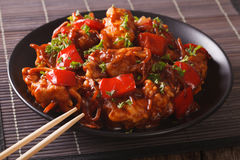 Spicy pork with peppers, carrots and onions in sweet and sour sa Royalty Free Stock Images