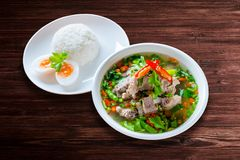 Spicy Pork with Pork bone Soup with Rice and Egg on the Wood Tab Stock Image