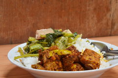 Spicy pork rib stir with curry and flat bean. On rice royalty free stock images