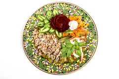 Spicy pork salad decorated by carving vegetable Stock Image