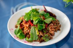 Spicy pork with spicy thai food. Spicy pork with spicy, with glutinous rice royalty free stock photography