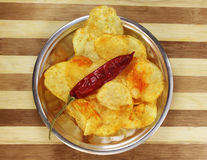 Spicy Potato Chips on the plate Royalty Free Stock Photos