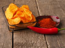 Spicy potato chips Stock Images