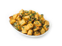 Spicy potato cut in cubes and fried isolated Royalty Free Stock Photos