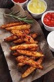 Spicy potato wedges Stock Image
