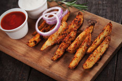 Spicy potato wedges Stock Photos