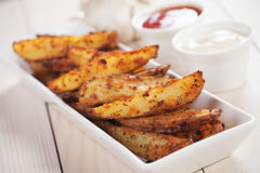 Spicy potato wedges Stock Image