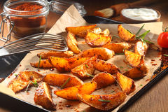 Spicy Potato Wedges on Tray with Paper Royalty Free Stock Image