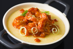 Spicy Prawns & Polenta. Spicy Prawns & Polenta - Soft polenta with goat's cheese topped with prawns in tomato and chili sauce garnished with spring onion Royalty Free Stock Image