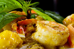 Spicy Prawns in sauce. Large prawns in sauce for dinner with fresh herbs Royalty Free Stock Images