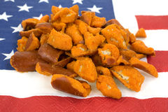 Spicy pretzel pieces on napkin Stock Photo