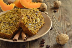 Spicy pumpkin cupcake with raisins and nuts Royalty Free Stock Photos