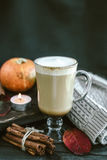 Spicy pumpkin latte on a wooden board with a sweater Stock Images