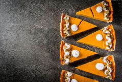 Spicy pumpkin pie and tartlets Royalty Free Stock Photo