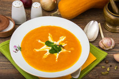 Spicy pumpkin puree soup. Studio Photo Royalty Free Stock Image
