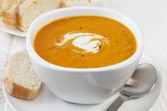 Spicy Pumpkin Soup with Coconut Cream stock photo