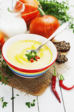 Spicy pumpkin soup with cream and chili pepper Royalty Free Stock Image