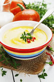 Spicy pumpkin soup with cream and chili pepper Stock Photo