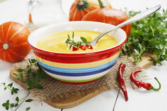 Spicy pumpkin soup with cream and chili pepper Royalty Free Stock Photos