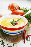 Spicy pumpkin soup with cream and chili pepper Royalty Free Stock Images
