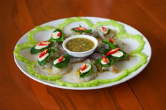 Spicy raw shrimp in fish sauce on white plate, Thai food Stock Photography