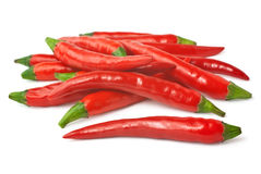 Spicy red chilies isolated on white background. Pile of red hot peppers isolated on white background Royalty Free Stock Images