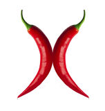 Spicy red chilli. Es and curves forming an X Stock Image