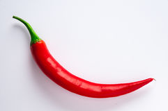Spicy red chilli. And curve on white background Stock Photography