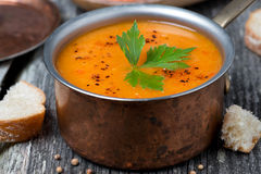 Spicy red lentil soup in a copper saucepan, close-up Stock Images