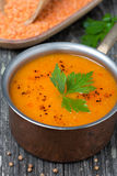 Spicy red lentil soup in a copper saucepan, close-up, top view Stock Photography