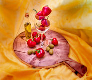 Spicy red peppers and oil. Spicy red peppers and olive oil on wooden cutting board Royalty Free Stock Image