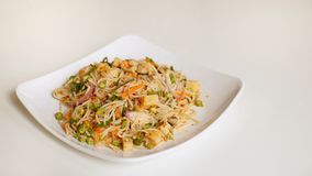 Spicy rice noodle salad , Thai street food. Spicy rice noodle salad thai street food  white dish mealball vegetable carrot green orange chili sliced market stock photography