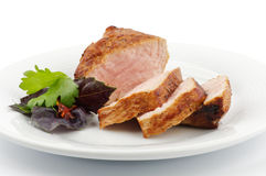 Spicy roast pork. With basil and pasley closeup on white background Stock Image