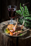 Spicy roasted lamb ribs served with red wine Stock Photo