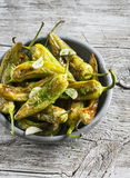 Spicy roasted peppers with garlic and herbs Royalty Free Stock Images