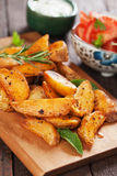 Spicy roasted potato wedges Royalty Free Stock Images