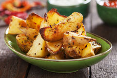 Spicy roasted potato wedges Royalty Free Stock Photos