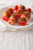 Spicy rolls of chicken breast with bacon on a plate close-up. ve Stock Images