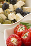 Spicy round red peppers stuffed with cheese Stock Photo