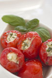 Spicy round red peppers stuffed with cheese Stock Image