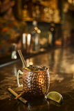Spicy rum cinnamon lime cocktail drink in bar Royalty Free Stock Photos