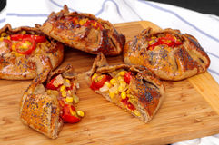 Spicy rye galettes with tomatoes, corn and ricotta Stock Photo