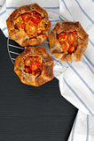 Spicy rye galettes with tomatoes, corn and ricotta. Mini rye galettes with tomatoes, corn and ricotta Stock Photo